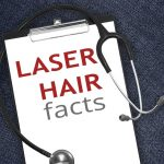 laser hair facts on a clip board
