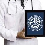 Doctor holding American Board of Surgery